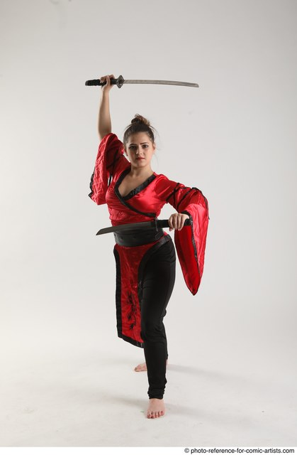 Woman Adult Average Fighting with sword Standing poses Coat Latino