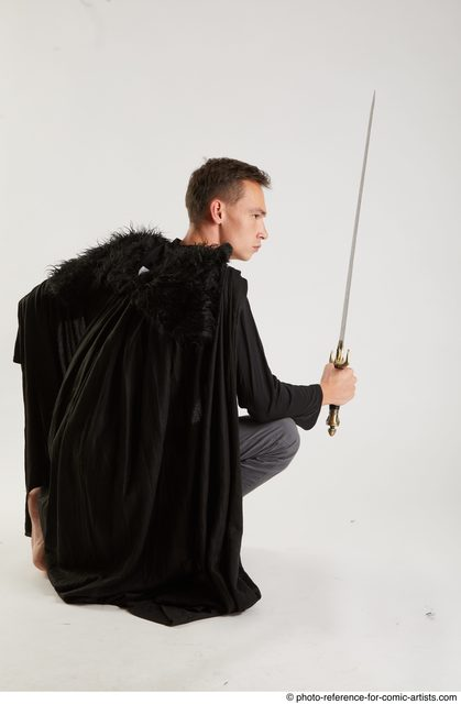 Man Adult Athletic White Fighting with sword Kneeling poses Coat