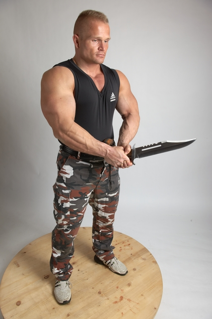 Man Adult Muscular White Fighting with sword Standing poses Casual