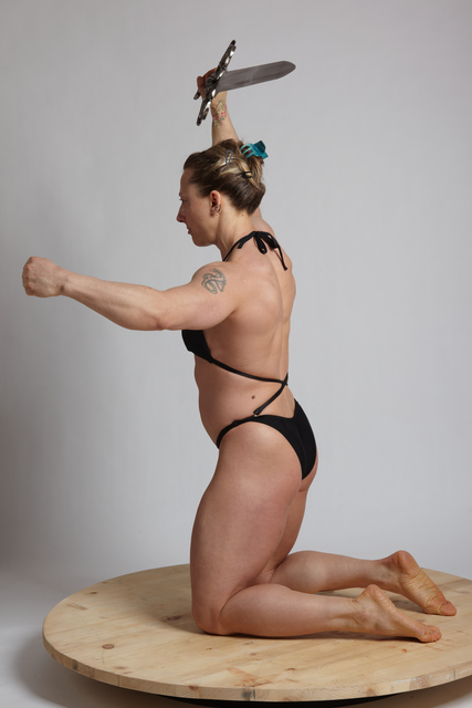 Woman Adult Muscular White Fighting with sword Kneeling poses Underwear