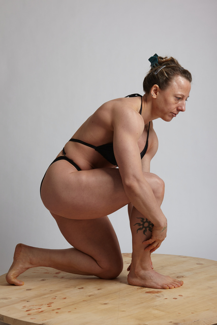 Woman Adult Muscular White Daily activities Kneeling poses Underwear