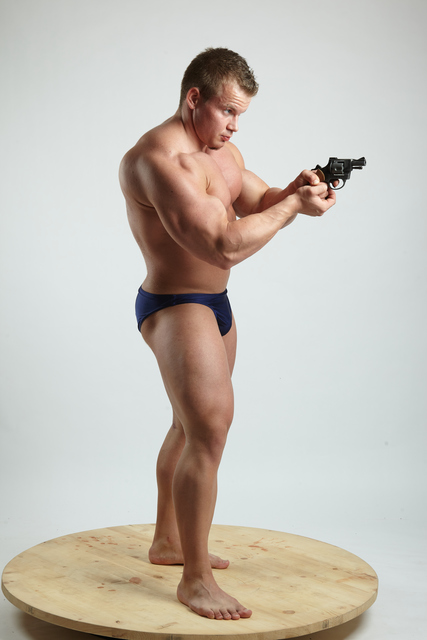 Man Adult Muscular White Fighting with gun Standing poses Underwear