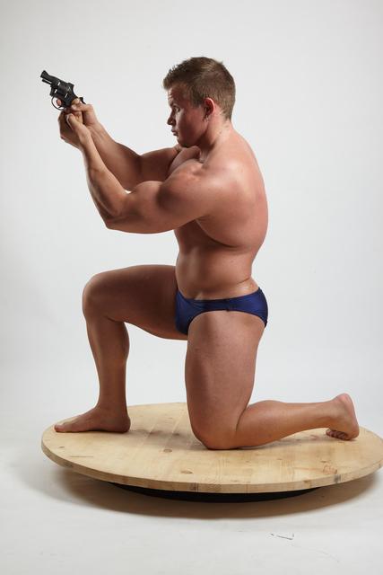 Man Adult Muscular White Fighting with gun Kneeling poses Underwear