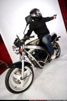 biker-shooting-back-pistol