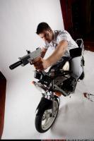 biker2-shooting-front-uzi