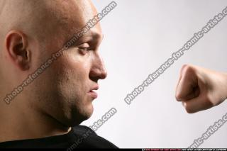 FIST IN FRONT OF FACE 08