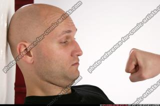 FIST IN FRONT OF FACE 00