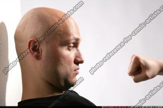 FIST IN FRONT OF FACE 07