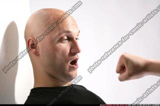 FIST IN FRONT OF FACE 06