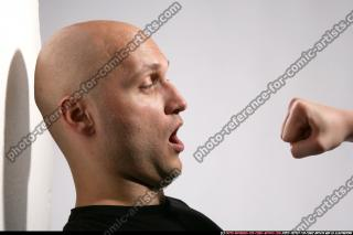 FIST IN FRONT OF FACE 04