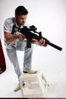 MERCENARY4 STANDING ON CHAIR AIMING HK 04.jpg