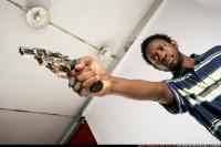 TEENAGER SHOOTING REVOLVER 12.jpg
