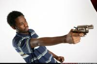 TEENAGER SHOOTING REVOLVER 24.jpg