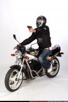 biker-shooting-front-pistol