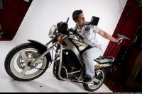 biker2-shooting-back-uzi