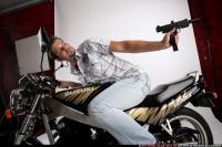 2009 02 BIKER2 SHOOTING BACK UZI 09
