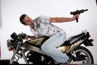 2009 02 BIKER2 SHOOTING BACK UZI 12