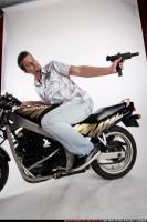 2009 02 BIKER2 SHOOTING BACK UZI 04