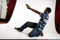 2009 02 TEENAGER LEANING AIMING PISTOL 06.jpg