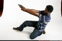 2009 02 TEENAGER LEANING AIMING PISTOL 05.jpg