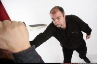 2009 03 MEN KNIFE FIGHT 08.jpg