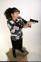 2009 08 OLDWOMAN STANDING AIMING PISTOL LIGHT 01 A.jpg