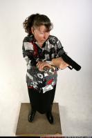 2009 08 OLDWOMAN STANDING AIMING PISTOL LIGHT 00 A.jpg
