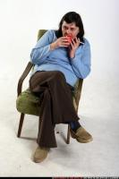2009 12 OLDWOMAN2 SITTING DRINKING SMOKING 01.jpg