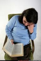 2010 01 OLDWOMAN2 SITTING READING 04.jpg
