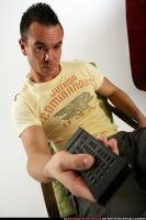 2010 01 JOHNNY WATCHING TV REMOTE CONTROL 09.jpg