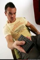 2010 01 JOHNNY WATCHING TV REMOTE CONTROL 08.jpg