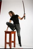 2010 04 WOMAN LEAN AGAINST CHAIR KATANA 00.jpg