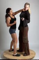 2010 05 WOMEN PUNCH IN NECK 01.jpg