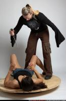 2010 06 WOMEN KNIFE ATTACK LAYING 01 B.jpg
