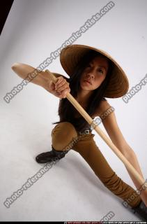 2011 05 NAOMI KNEELING STICK POSE 08