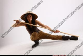 2011 05 NAOMI KNEELING STICK POSE 00