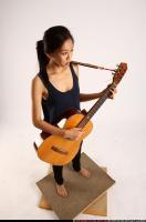 2012 03 NAOMI PLAYING GUITAR 07 A