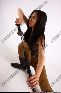 2012 06 NAOMI UNSHEATHING KATANA 10