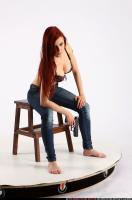 2013 06 NINA SITTING PISTOL POSE1 01