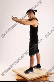 2014 06 TRIAD MOB STANDING AIMING PISTOL 01 B