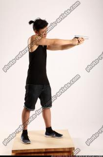 2014 06 TRIAD MOB STANDING AIMING PISTOL 06 B
