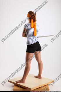 2014 08 AMY PIRATE FLINTLOCK SWORD GUARDING POSE 03 B
