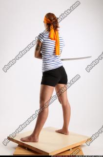 2014 08 AMY PIRATE FLINTLOCK SWORD GUARDING POSE 03 C