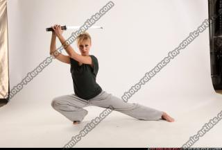 2015 11 RACHEL KNEELING SWORD POSE 00
