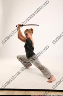 2015 11 RACHEL KNEELING SWORD POSE 01