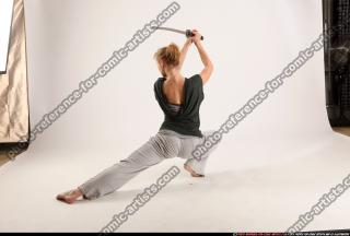 2015 11 RACHEL KNEELING SWORD POSE 03
