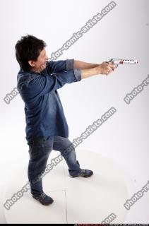 2016 10 ORVILLE STANDING AIMING PISTOL 06 A
