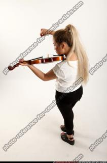 2016 11 KAYA STANDING PLAYING VIOLIN 02 A