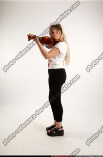 2016 11 KAYA STANDING PLAYING VIOLIN 01 C