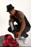 2017 03 MARCUS TOMMYGUN CASE VARIOUS POSES 09
